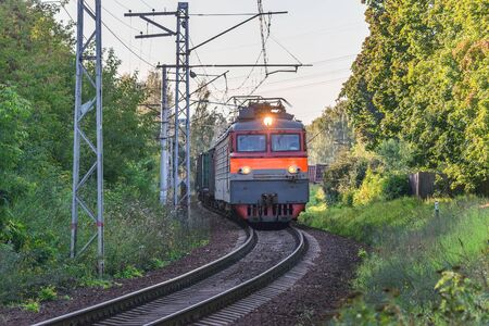 Freight train moves at evening summer time. Russia.