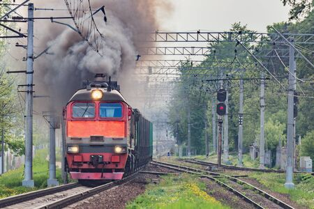 Freight train departs from the railway station.