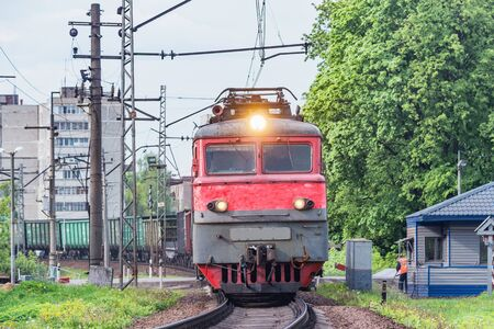 Freight train crosses the road. Russia. 写真素材