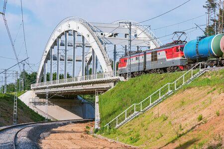 Freight train moves through the new bridge.
