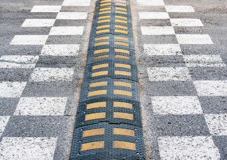 Traffic safety speed bump. 免版税图像
