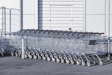 Shopping carts on the street by the supermarket.