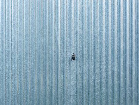 White corrugated metal gate.