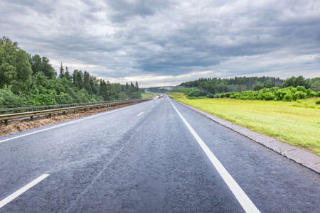 View of the new highway at cloudy summer morning.