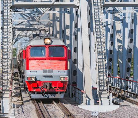 Diesel freight train moves through the bridge.
