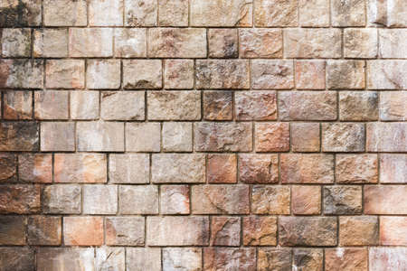Wet colorful brick wall background.