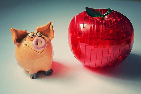 Piglet and apple