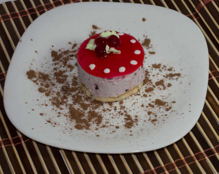 largely: cake in the form of a mushroom on a white plate, largely