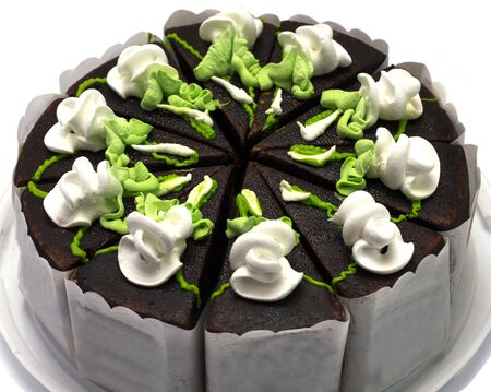 largely: chocolate pie with green and white cream, largely, on a plastic tray