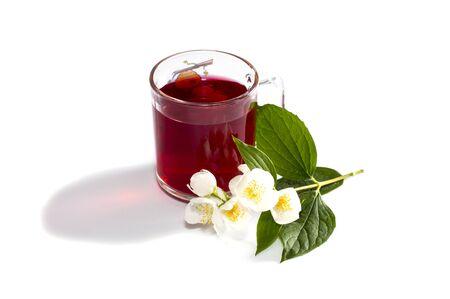 mug of red tea nearby flower photo
