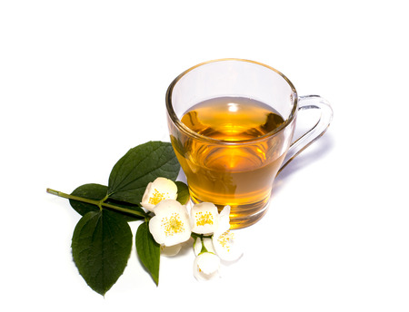 english ethnicity: glass of the lime tea decorated with a flower branch Stock Photo