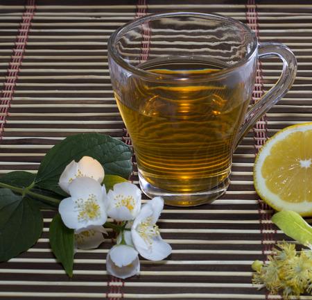 glass of lime tea with a lemon close up photo