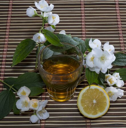the tea decorated with branches of the blossoming bush photo