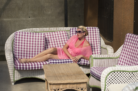 pink bikini: the beautiful woman in the pink lies on a sofa