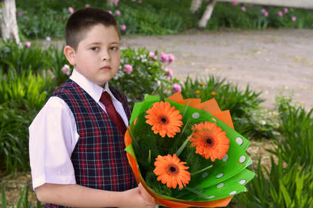 beginning school year: On September 1 the school student with a beautiful bouquet of flowers Stock Photo