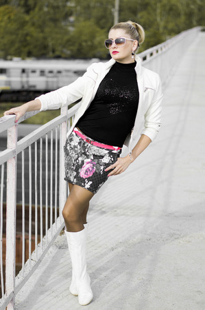 miniskirt: the beautiful woman in a miniskirt, over the railroad, a subject fashionable women in unusual places