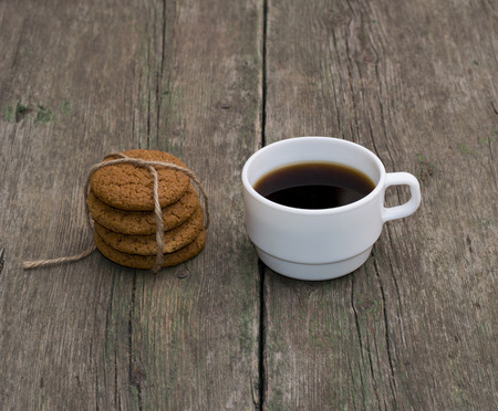 non alcoholic beverage: cup of coffee and linking of oatmeal cookies, subject food and drinks Stock Photo