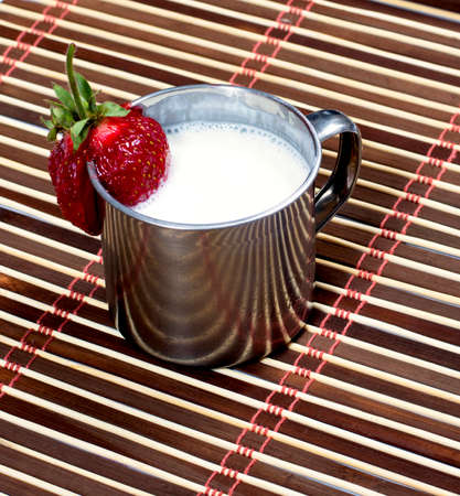 steel  milk: milk cocktail in a steel mug, on a rug, a subject drinks Stock Photo