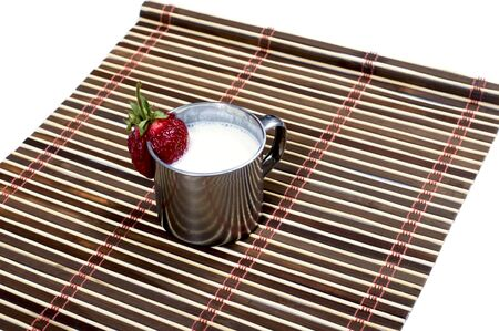 steel  milk: steel mug with milk drink on a rug, isolate, a subject drinks