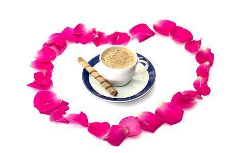 heart from petals of roses, inside a cup of coffee, a subject drinks and holidays Stock Photo