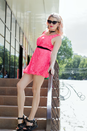 beautiful woman on the steps of the supermarket, theme beautiful colorful women summer