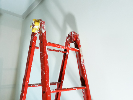 Different angles of a painters ladder in a room to be refurbished