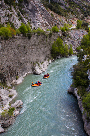 Rafting in a river of Huesca, Spain. Rafting at Tara mountain river. Group of tourists in the inflatable raft