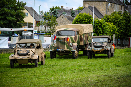 Normandy, France; 4 June 2014:Image of two Kugelwagen and a German army truck in Normandy in a camp. Recreation on the 70th anniversary Stock fotó