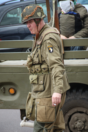 Normandy, France; 4 June 2014: Recreation of American soldier in Normandy smoking