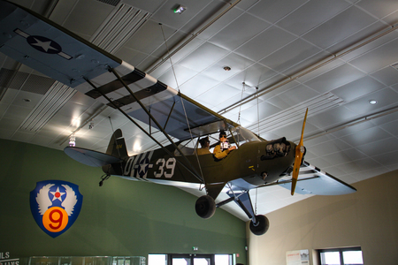 Taylorcraft L-2. American reconnaissance aircraft in World War II. Painted yellow for exhibition