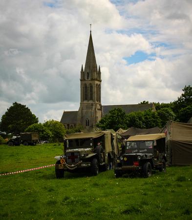 Normandy, France; 4 June 2014: Vintage U.S. army WWII vehicles on display