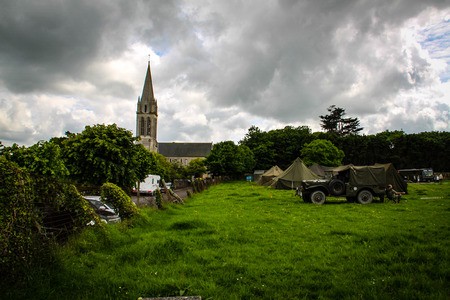 Normandy, France; 4 June 2014: View of recreation camp in Normandy for the 70th anniversary with vehicles and tents