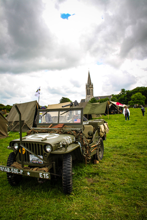 Normandy, France; 4 June 2014: Image of an American army jeep in Normandy in a camp. Recreation on the 70th anniversary.
