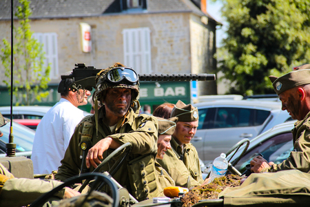 Normandy, France; 4 June 2014: Recreation of American soldier in Normandy with camouflage face.