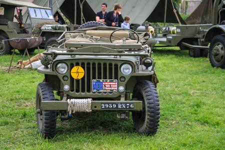 Normandy, France; 4 June 2014: Normandy, France; 4 June 2014: Vintage U.S. army WWII jeep on display Redactioneel