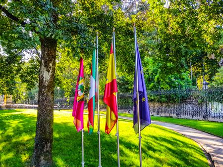 flags of Guernika, Euskadi, Spain and Europe next to the tree of Gernika, symbol of freedom.