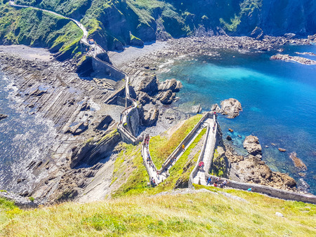 Hermitage of San Juan de Gaztelugatxe at the top of the island of Gaztelugatxe. Vizcaya, Basque Country (Spain). View of the stairs to ascend Redactioneel