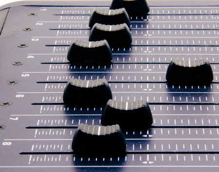Audio mixer, mixing desk controls and fader, music mixing console with degraded effects for banners and backgrounds Banque d'images