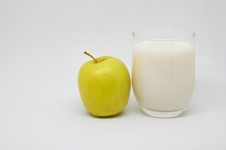 Apple and milk. Healthy eating concept for breakfast and a good start to the day. 写真素材