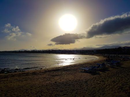 Los Pocillos beach at sunset. Lanzarote, Canary Islands, Spain Фото со стока