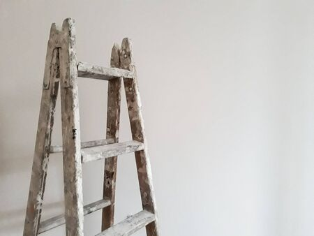 Different angles of a painter's ladder in a room to be refurbished Stockfoto