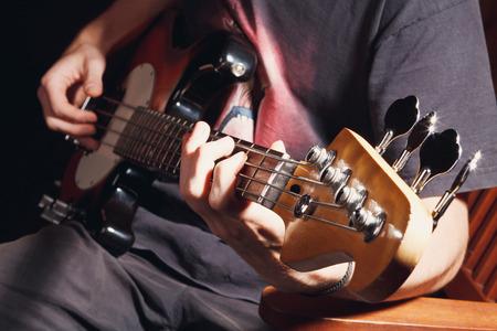 guy playing bass, guitar close-гз