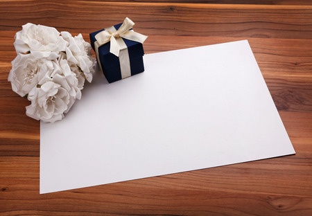 blue gift box: Greeting card with white flowers and a blue gift box