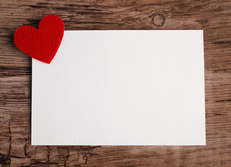 greeting card with a red heart and space for text on a wooden background Archivio Fotografico