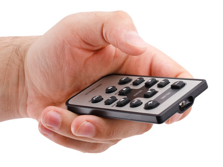 remote controls: remote controller in hand on white background