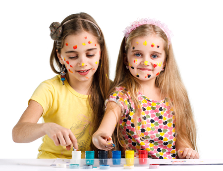 5 6 years: two girls painted with colorful paint Stock Photo