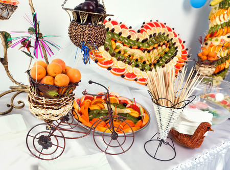 fruit buffet with fruit  heart and fruit pyramid heart photo