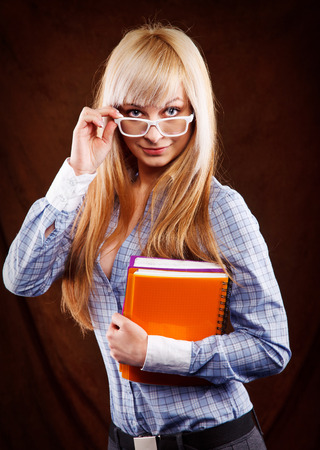 teenagers school: beautiful blonde student with notebooks