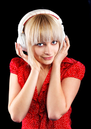 beautiful blonde girl listens to music in the headphones photo