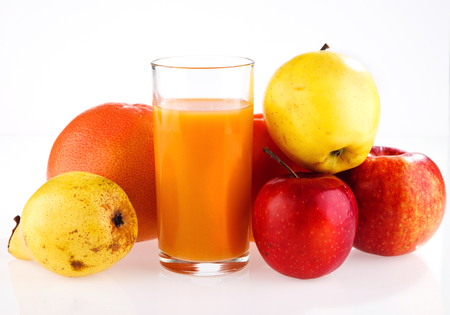 apple, pear, grapefruit, a glass of juice on a white background